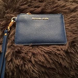 A Michael Kors key chain or coin purse..NWOT